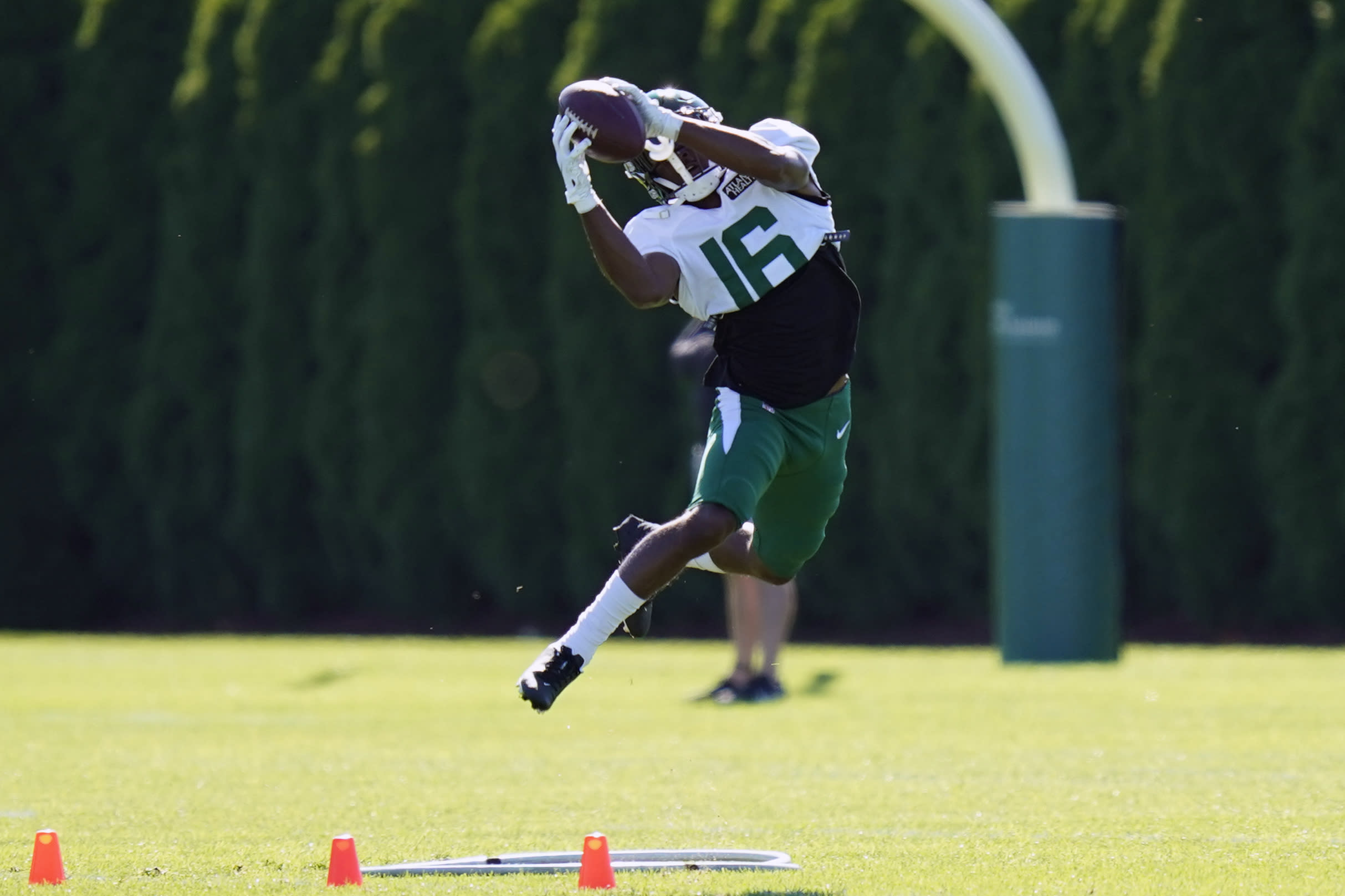 New York Jets' Jeff Smith makes a catch during practice at the NFL football team's training camp in Florham Park, N.J., Thursday, Aug. 20, 2020. Jeff Smith was a quarterback for as long as he can remember before a position switch to wide receiver in college. It turned out to be his unexpected path to the NFL. (AP Photo/Seth Wenig)