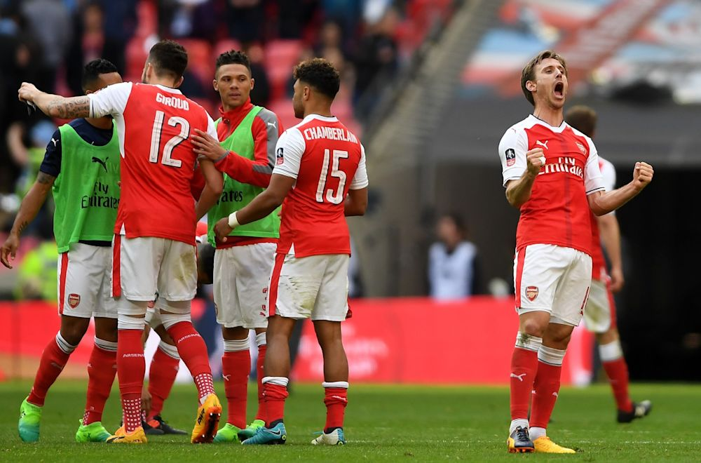 Nacho Monreal (R) and Arsenal players celebrate their 2-1 victory in the Emirates FA Cup Semi-Final match between Arsenal and Manchester City at Wembley Stadium