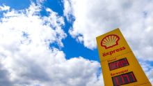 London markets held back by tumbling pound and Shell profit plunge