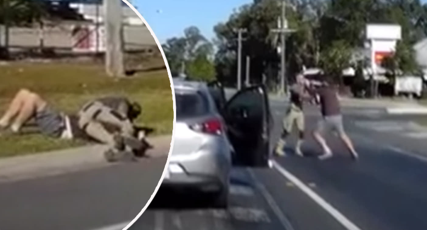 Men wrestle across lanes in Queensland road rage fight caught on camera