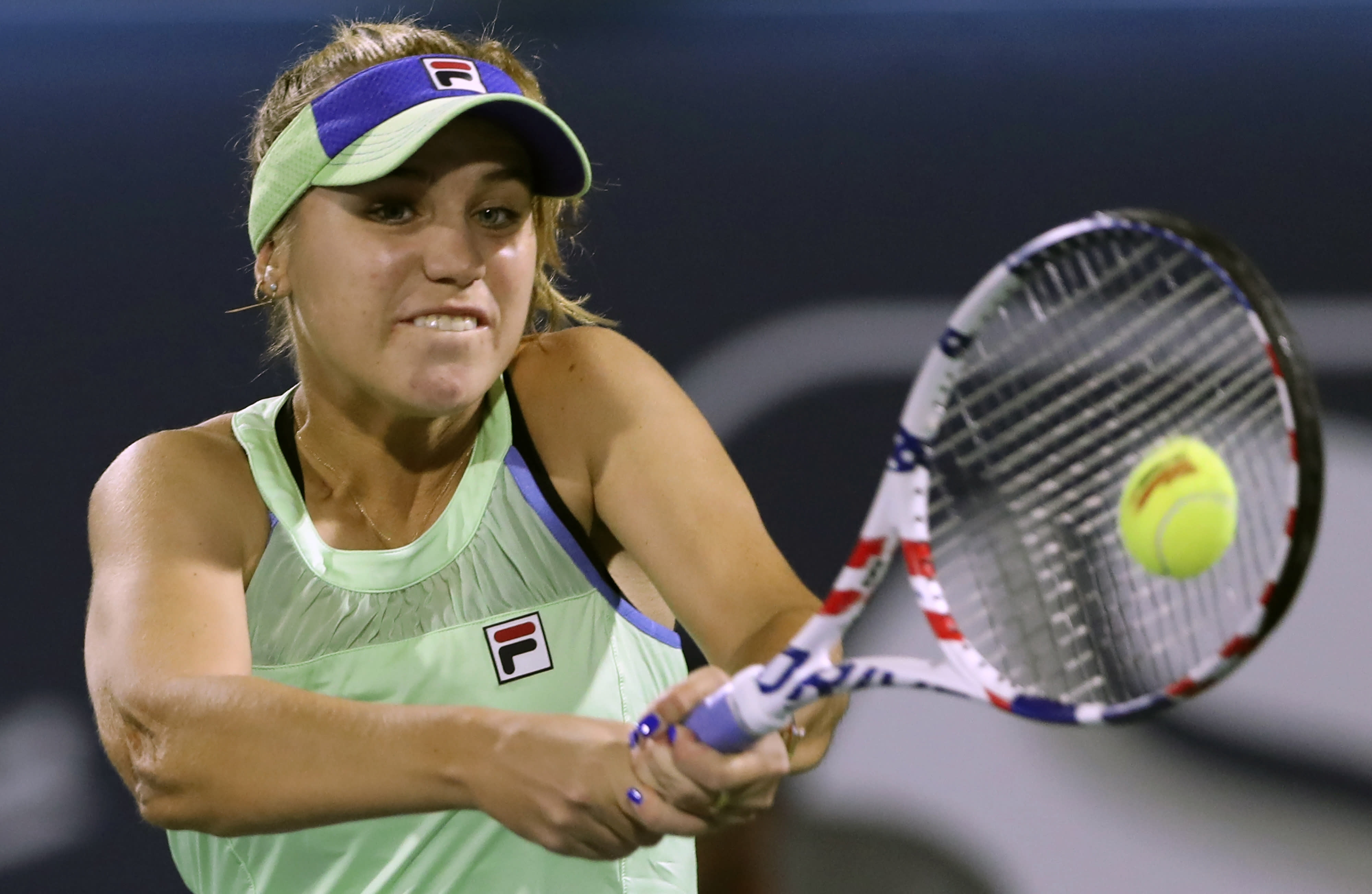 FILE - In this Feb. 18, 2020, file photo, Sofia Kenin returns the ball to Kazakhstan's Elena Rybakina during a match of the Dubai Duty Free Tennis Championship in Dubai, United Arab Emirates. Kenin is scheduled to play in the U.S. Open, scheduled for Aug. 31-Sept. 13, 2020.(AP Photo/Kamran Jebreili, File)