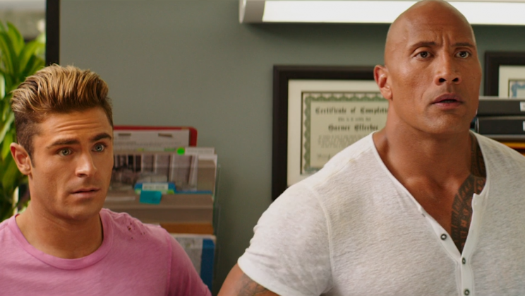 Zac Efron and Dwayne Johnson in <em>Baywatch</em>.