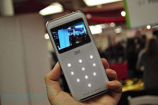 3M Shoot 'N Share does just that: shoots 720p, shares with its built-in pico