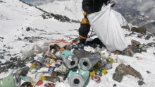 China to cut numbers of Everest climbers by a third as rubbish clean-up begins