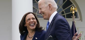 'A great day for America,' a maskless Biden beams