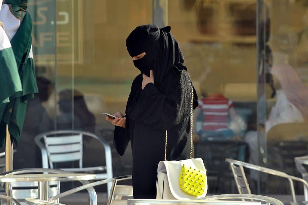 A Saudi woman looks at her mobile phone in the capital Riyadh
