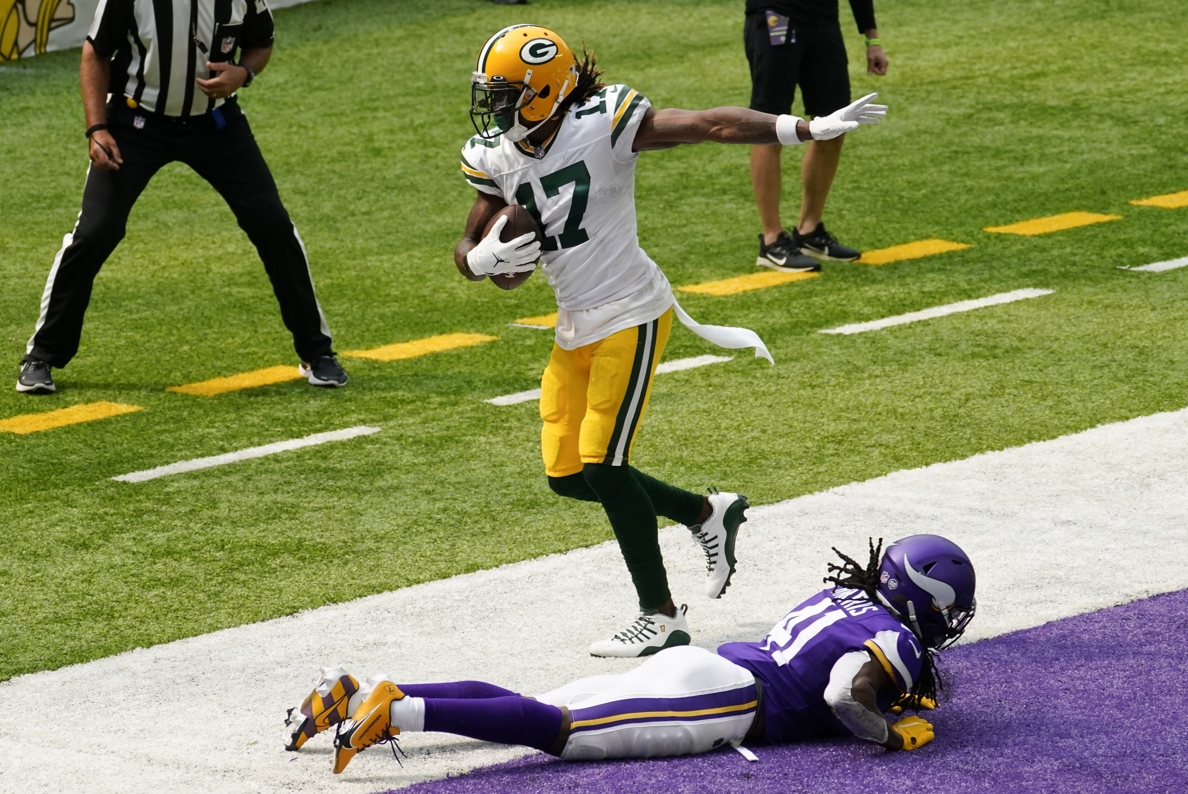 Green Bay Packers wide receiver Davante Adams (17) catches a 24-yard touchdown pass over Minnesota Vikings defensive back Anthony Harris during the first half of an NFL football game, Sunday, Sept. 13, 2020, in Minneapolis. (AP Photo/Jim Mone)