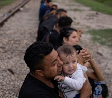 Texas plans $1bn Trump-style border wall to tackle record migrant surge