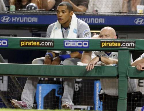 Major League Baseball is looking into domestic abuse allegations against Cubs shortstop Addison Russell. (AP Photo)