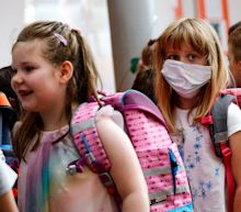 German schools forced to close after teacher and pupil test positive for virus