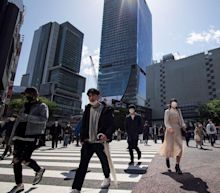 Asian markets gain amid cautious outlook for global economy