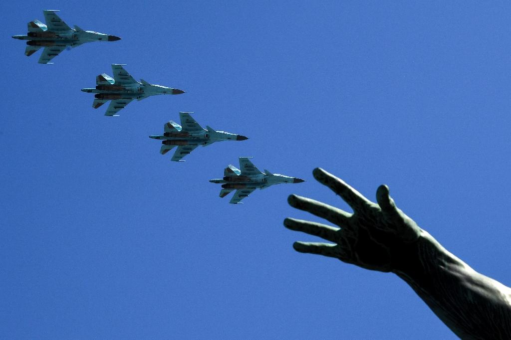 Russian Sukhoi Su-34 fighter-bombers fly over Red Square during the Victory Day military parade in Moscow on May 9, 2018