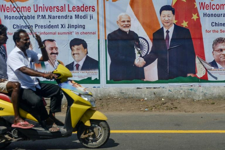 At summit to mend ties, Modi, Xi see common challenge on 'terror'