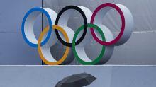 GLIMPSES: As rain arrives and typhoon nears, Olympics endure
