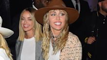 Miley Cyrus holds hands with Kaitlynn Carter after emotional VMAs performance