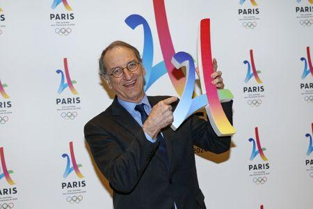 President of the French National Olympic and Sports Committee Denis Masseglia holds the logo as he attends the presentation of the Paris candidacy for the 2024 Olympic and Paralympic Games in Paris