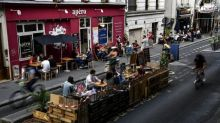 Makeshift patios take over Paris streets in virus summer