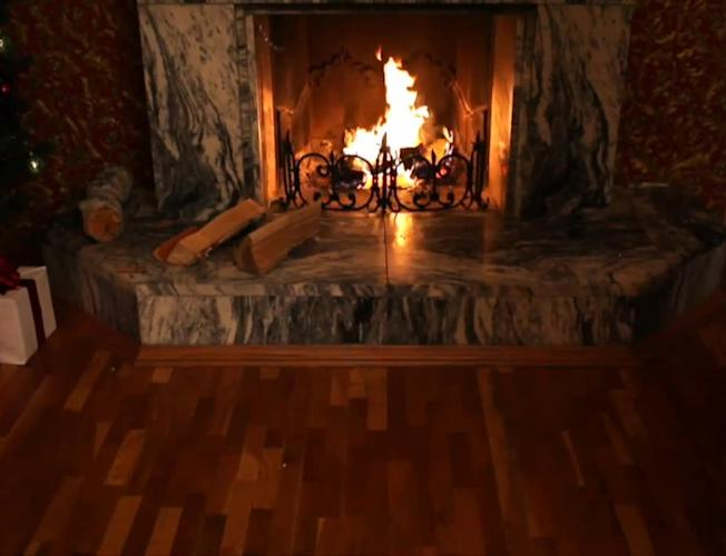 Christmas music by the fireplace [Video]