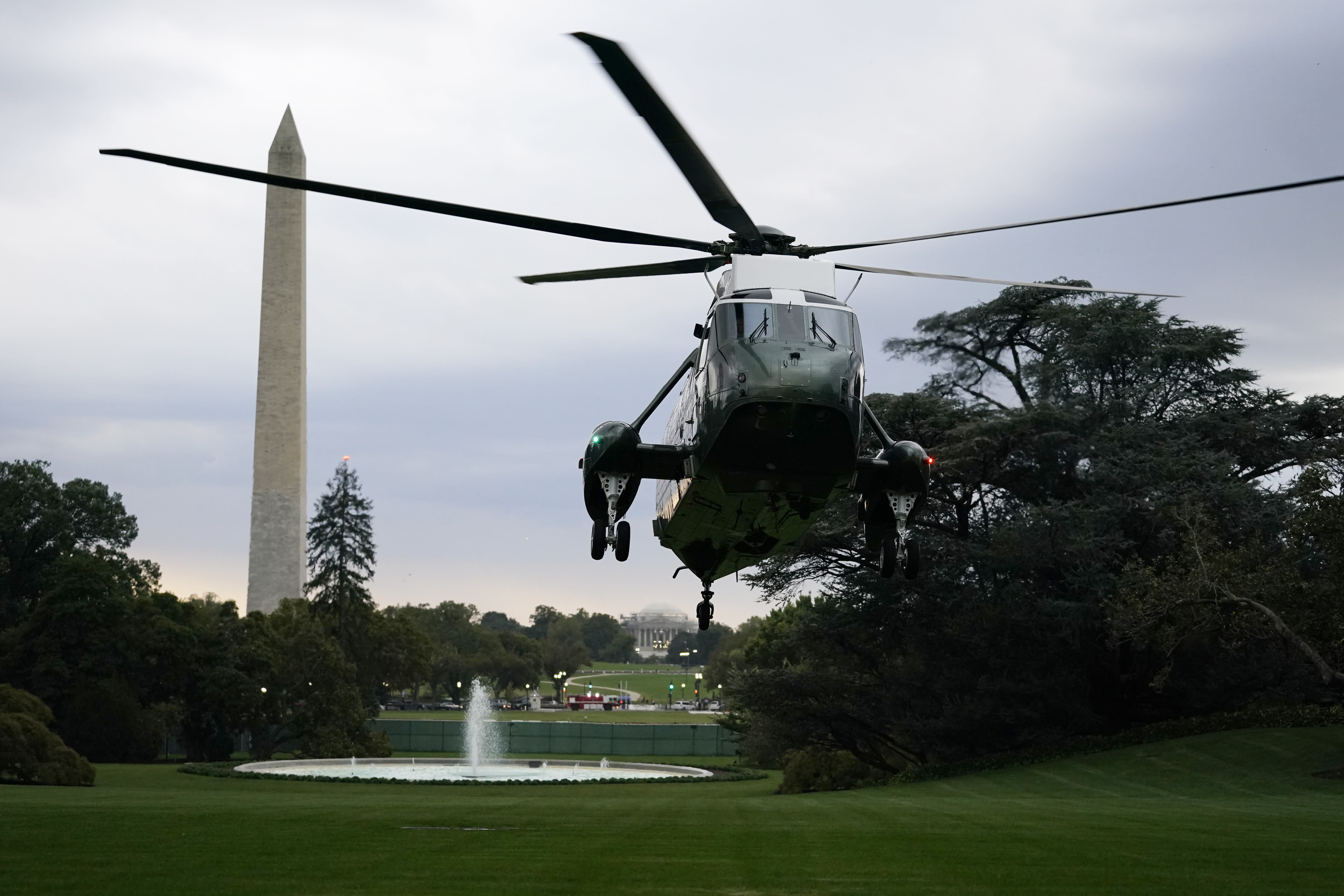 Marine One with President Donald Trump aboard lands on the South Lawn in Washington, Thursday, Oct. 1, 2020, as Trump returns from Bedminster, N.J. (AP Photo/Carolyn Kaster)