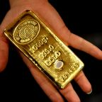 Gold prices settle lower, then climb after Fed shifts away from 'patient' stance on rates