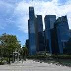 Singapore to close workplaces, schools in virus fight