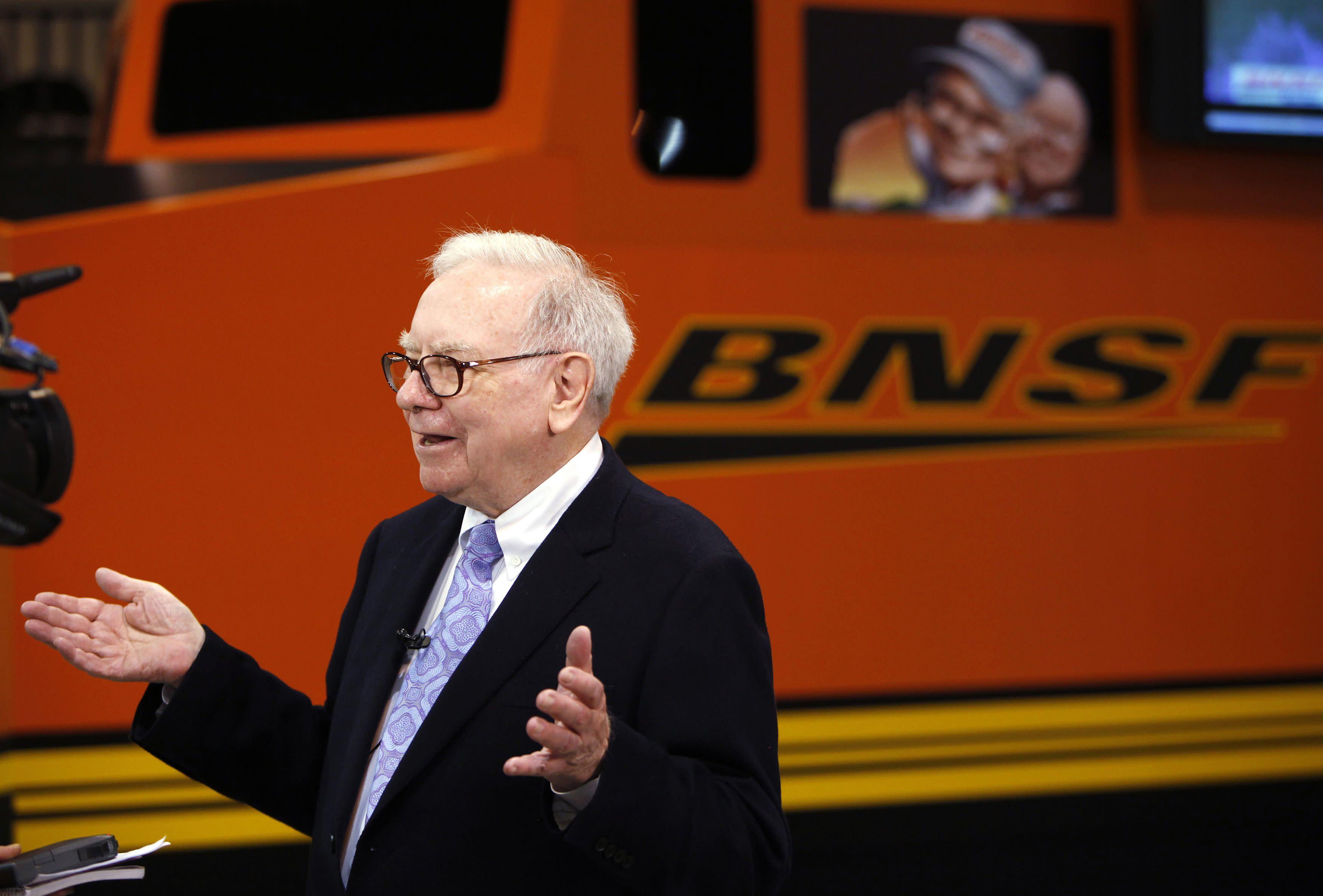 Berkshire Hathaway Chairman Warren Buffett talks in front of a mock BNSF railroad engine. REUTERS/Rick Wilking