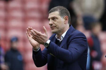 West Ham United manager Slaven Bilic applauds fans after the match