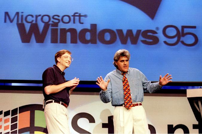 Microsoft Chairman Bill Gates (L) looks on  as The Tonight Show's Jay Leno co-hosts the official launch of Windows '95 at the Microsoft campus in Redmond, Washington August 24
