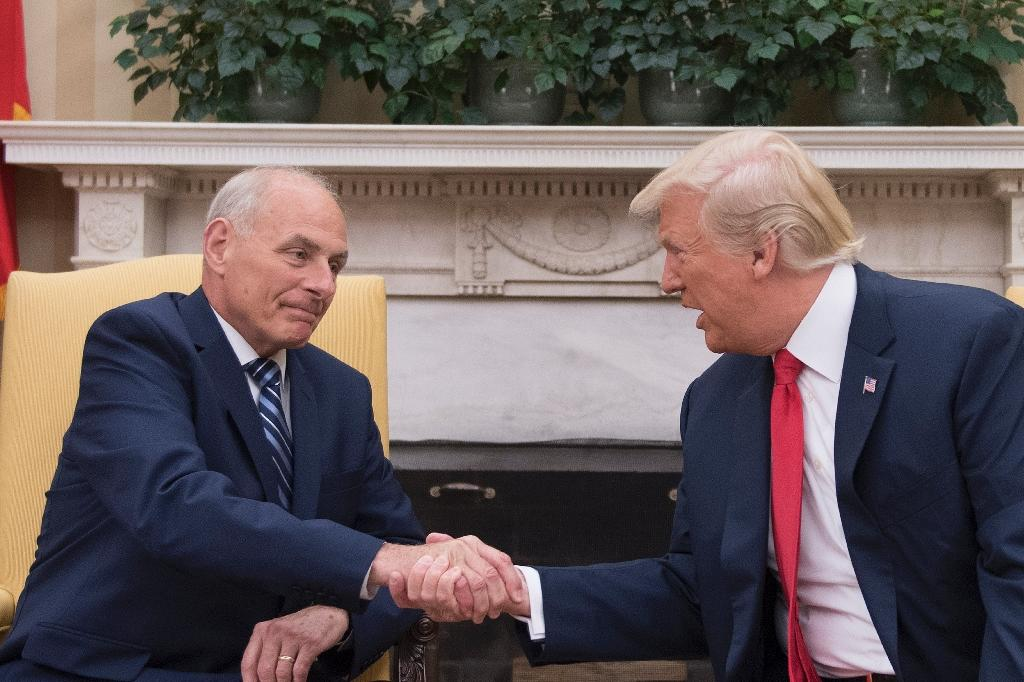 US President Donald Trump (R) shakes hands with newly sworn-in White House Chief of Staff John Kelly at the White House in Washington, DC (AFP Photo/JIM WATSON)