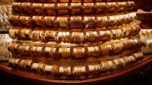 Gold prices dip as rallying stocks boost risk appetite