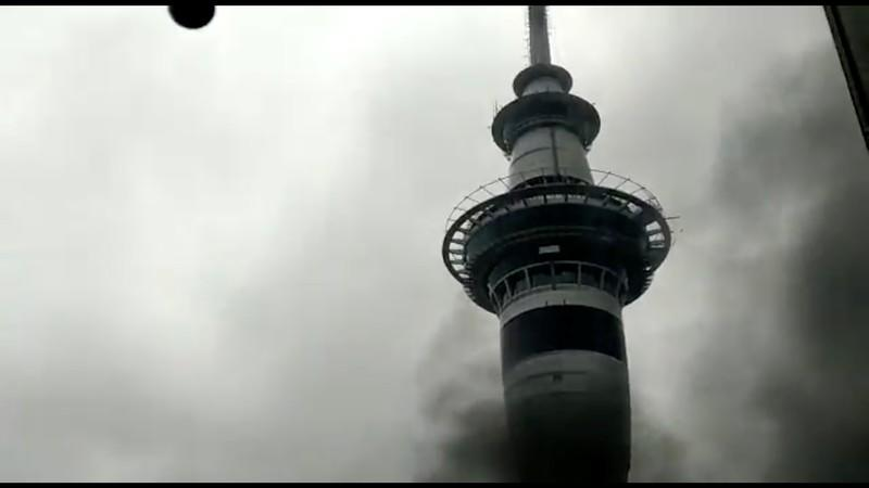 Smoke rises as a fire blazes at Sky City Convention Centre, which is under construction in Auckland