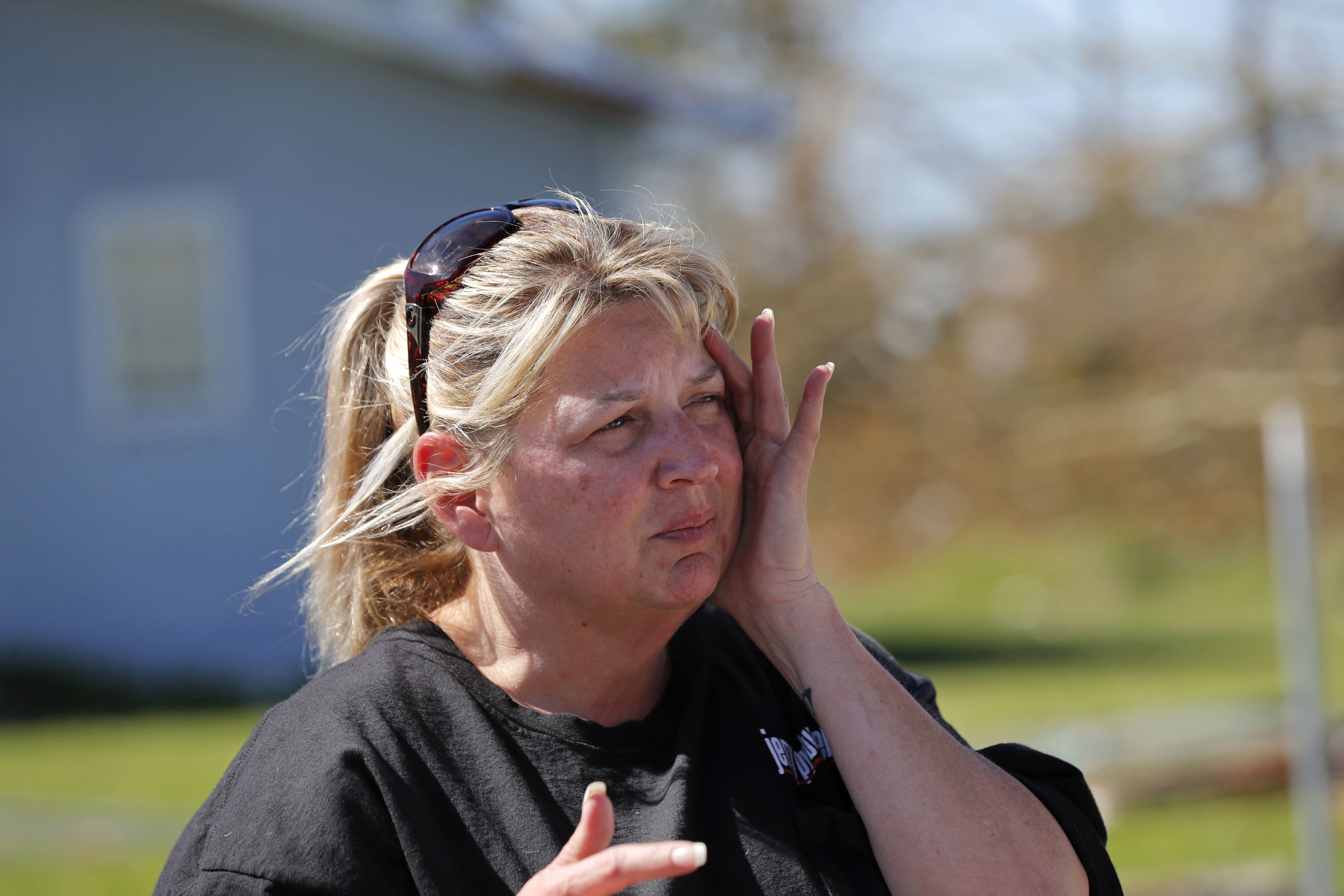 "In this Oct. 13, 2018 photo, Pam Rudd reacts as she helps her mother-in-law remove possessions from her damaged home in the aftermath of Hurricane Michael in Panama City, Fla. ""We're lucky that we at least have a place to stay,"" Rudd said. ""There are people walking up and down the road with backpacks and no place to go."" (AP Photo/Gerald Herbert)"