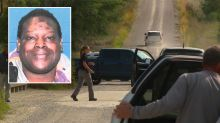 Body of black man found burning in roadside ditch