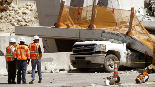 Cars, bodies found under collapsed Fla. bridge