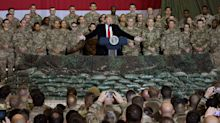 As Trump's troop remarks come under fire, a look at how he and Biden differ on military