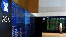 Aust shares close higher on banks, miners