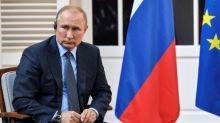 France's Macron urges Putin to respect democracy