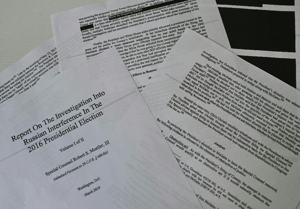 The Mueller Report is 450-odd pages long, with some parts blacked out, as seen here (AFP Photo/Eva HAMBACH)