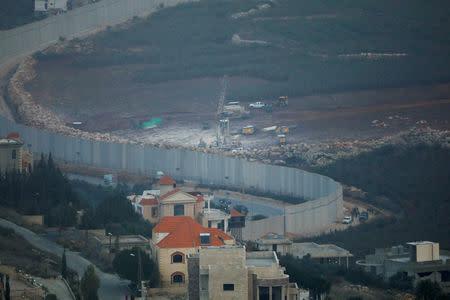 FILE PHOTO: Israeli drilling equipment is seen next to the border with Lebanon, near the Lebanese village of Kfar Kila, seen from the Israeli side December 4, 2018. REUTERS/Ronen Zvulun/File Photo