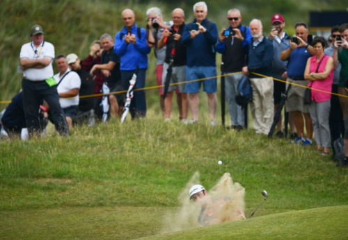 Bunkers at Birkdale, like this one hiding Jon Rahm, are wicked things. (Getty)