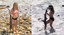 WATCH: Young girl rescues shark trapped on rocks in surf break
