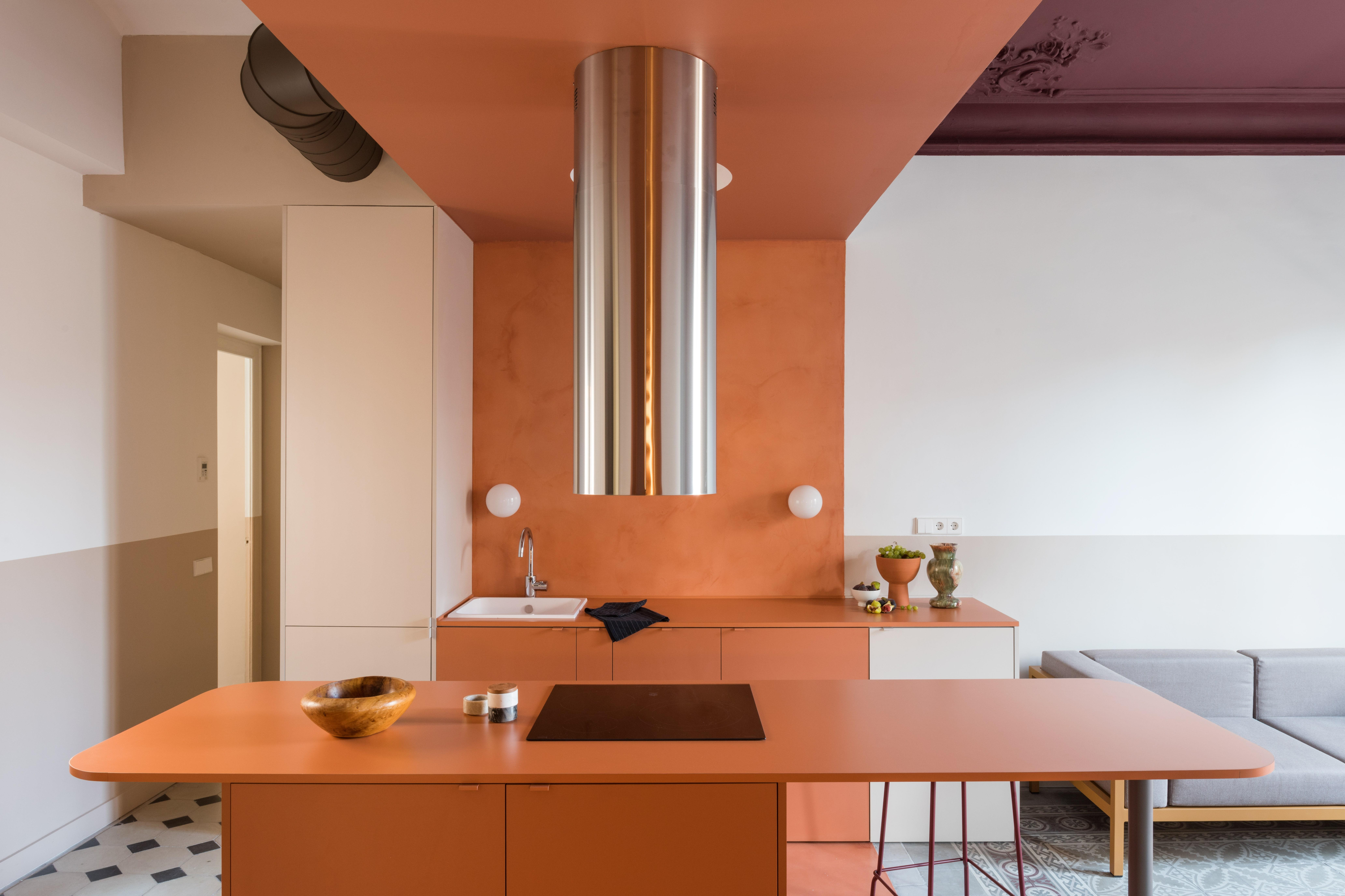 """California-based interior designer Marta Klinker worked with architects Andrea Serboli and Matteo Colombo of <a href=""""http://cargocollective.com/CaSA"""" rel=""""nofollow noopener"""" target=""""_blank"""" data-ylk=""""slk:CaSA"""" class=""""link rapid-noclick-resp"""">CaSA</a>, after the home she was renovating in <a href=""""https://www.architecturaldigest.com/story/after-a-tragic-fire-this-barcelona-apartment-was-rescued-by-color-blocking?mbid=synd_yahoo_rss"""" rel=""""nofollow noopener"""" target=""""_blank"""" data-ylk=""""slk:Barcelona"""" class=""""link rapid-noclick-resp"""">Barcelona</a> was destroyed in a fire. """"We came up with terra-cotta as an inexpensive solution for the kitchen countertops,"""" Matteo says. """"We found this color in <a href=""""https://www.architecturaldigest.com/story/behold-a-bold-solution-for-the-indecisive-renovator?mbid=synd_yahoo_rss"""" rel=""""nofollow noopener"""" target=""""_blank"""" data-ylk=""""slk:formica"""" class=""""link rapid-noclick-resp"""">formica</a>, and it did not look like a <a href=""""https://www.architecturaldigest.com/story/modern-laminate-design?mbid=synd_yahoo_rss"""" rel=""""nofollow noopener"""" target=""""_blank"""" data-ylk=""""slk:laminate"""" class=""""link rapid-noclick-resp"""">laminate</a>. So we decided to use it as a color-block in the kitchen and living area, to order the rest of the space."""""""