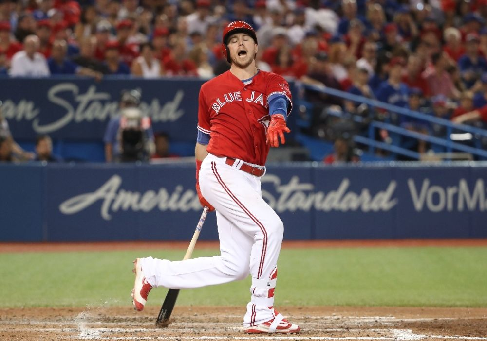 Is that the red uniforms fault, Justin Smoak? (AFP)