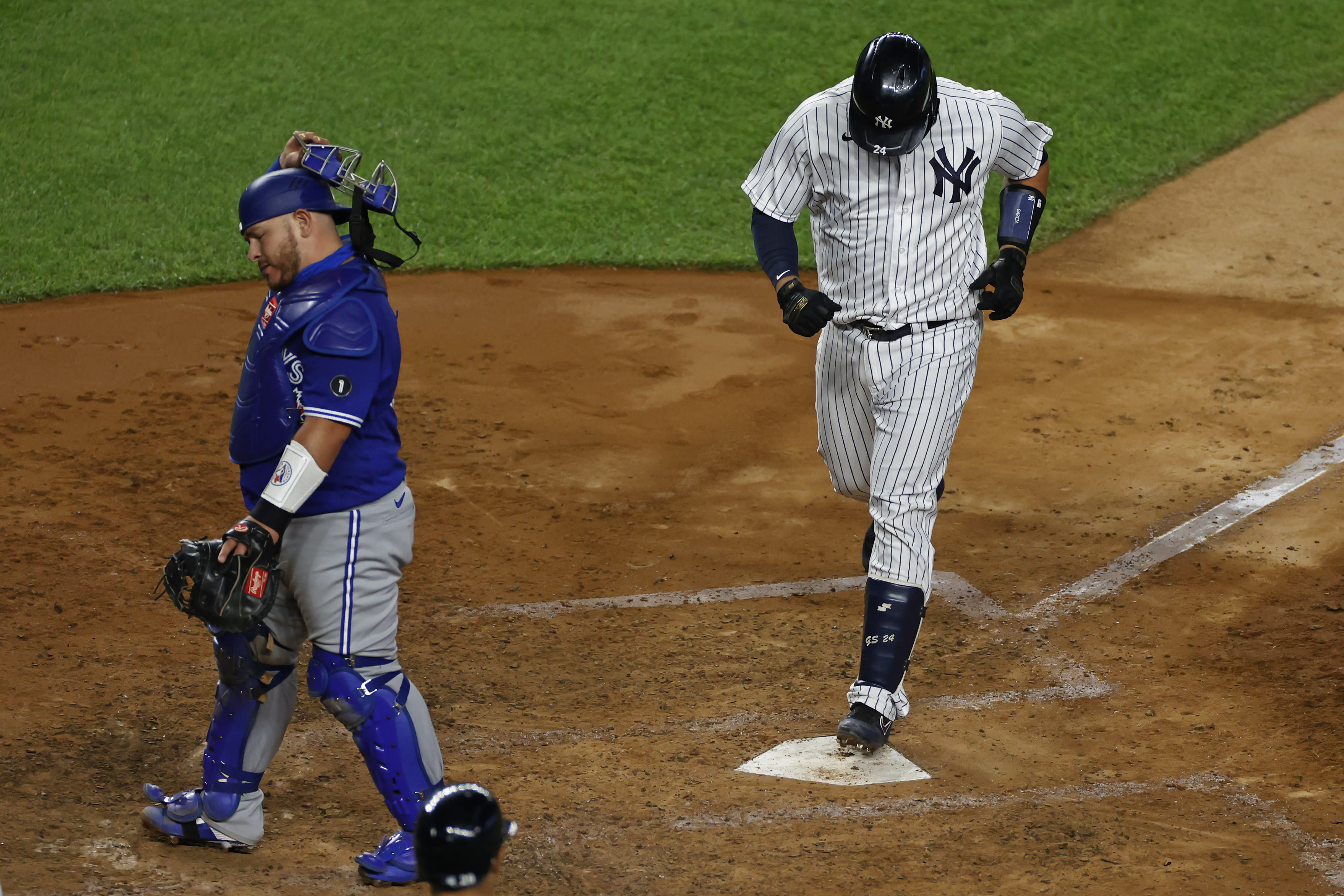 Toronto Blue Jays catcher Alejandro Kirk turns away as New York Yankees' Gary Sanchez steps on home plate after hitting a three-run home run during the fourth inning of a baseball game on Tuesday, Sept. 15, 2020, in New York. (AP Photo/Adam Hunger)