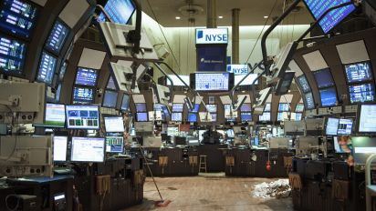 Stock futures slightly lower after Tuesday's late-day drop
