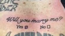 The moment a man proposes to his girlfriend - with a tattoo