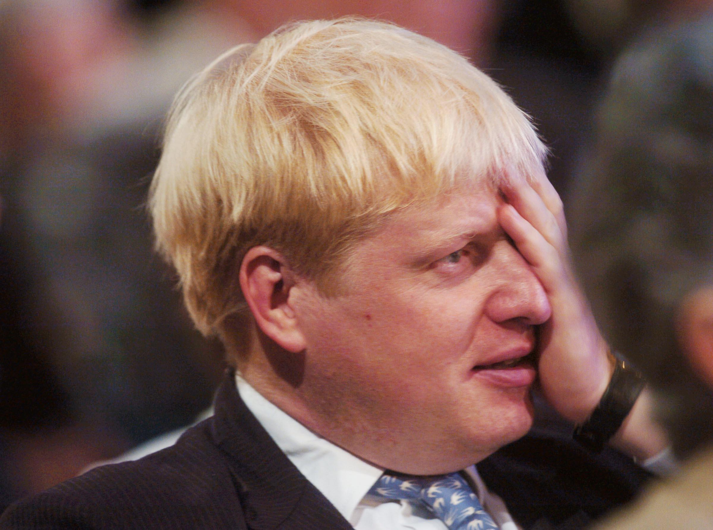 Conservative Party MP Boris Johnson sits through a series of speeches during the Conservative Party Conference in Bournemouth.