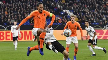 Van Dijk consoles grieving referee after German draw