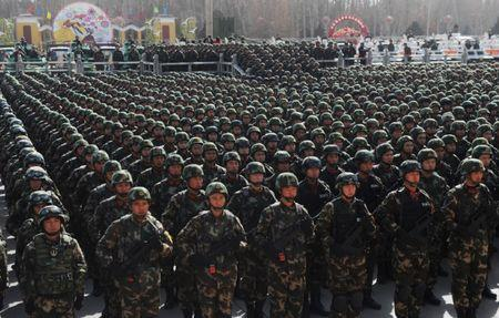 Paramilitary policemen stand in formation as they take part in an anti-terrorism oath-taking rally, in Kashgar