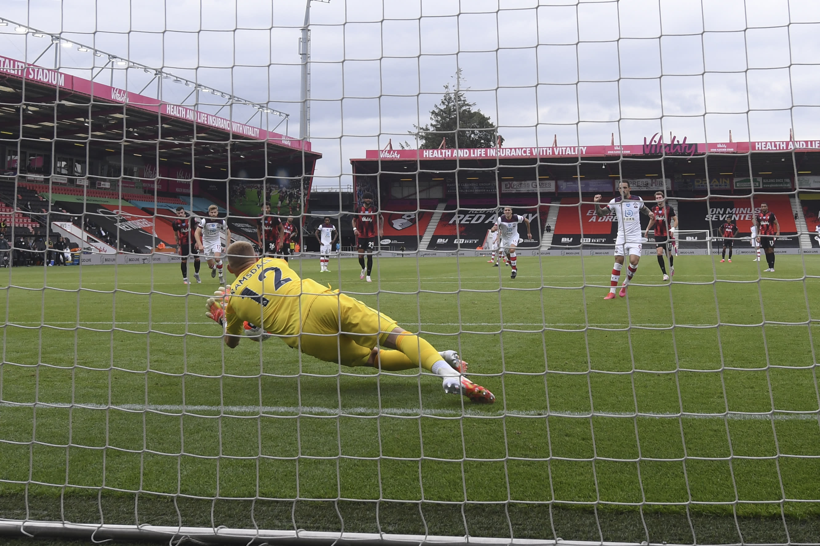 Bournemouth's goalkeeper Aaron Ramsdale saves a penalty during the English Premier League soccer match between Bournemouth and Southampton, at the Vitality Stadium in Bournemouth, England, Sunday, July 19, 2020. (Mike Hewitt/Pool Photo via AP)